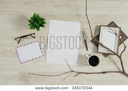 Letter paper with coffee on wood background. Rustic nostalgia. poster