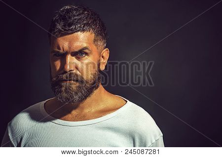 Serious Man. Serious Man With Beard And Mustache In White T-shirt. Stylish Man With Beautiful Hairst