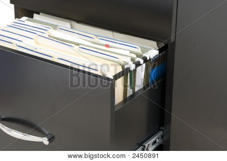 Opened Drawer From Black Cabinet