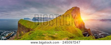 Shot Of Beautiful Panoramic Scene, Sunrise Over Kalsoy Island and Kallur lighthouse, Faroe Islands