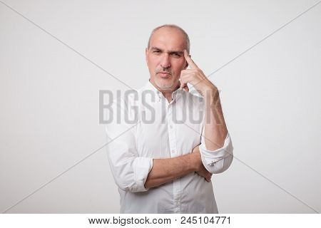 Mature Caucasian Man Thinking Pensive Looking Up Studio Portrait. He Is Trying To Make A Decision Or