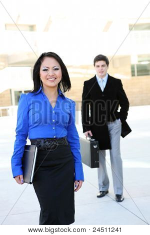 A young and pretty asian business woman at the office