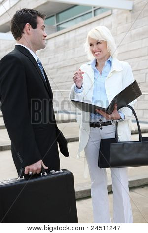 An attractive man and woman business team at the office building