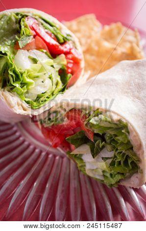 Healthy Diet Veggie Hummus Wrap On Red Tabletop