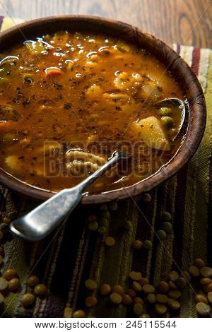 Rustic Homecooked Hearty Tomato Vegetable Soup In A Wooden Bowl