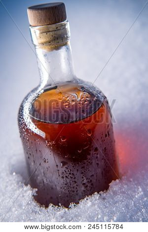 Ice Cold Home Made Whisky Resting In Frost