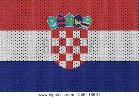 Croatia flag printed on a polyester nylon sportswear mesh fabric with some folds poster