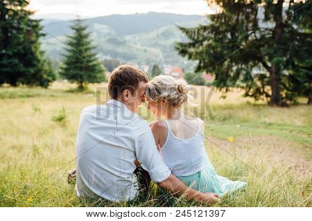 Couple In Love Walking In The Mountains, And Hills. Sensual And Gentle Loving Girl Look, The Sun Ray