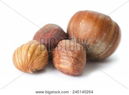 Heap Of Raw Hazelnuts Isolated On White Background