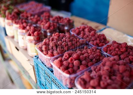 Raspberries On A Farm Market In The City. Fruits And Vegetables At A Farmers Market.