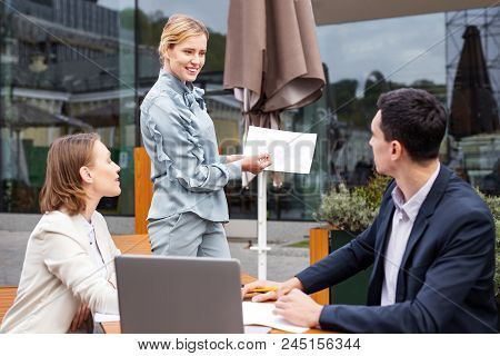 Foreign Investments. Smiling Stylish Businesswoman Wearing Nice Blouse Speaking About Future Foreign