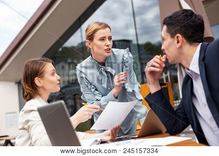 Prosperous Executives. Three Prosperous Executives Feeling Rather Employed While Discussing Future C