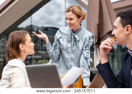 Smiling Boss. Smiling Boss Wearing Stylish Blouse Feeling Excited While Telling Colleagues About The