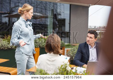 Career Woman. Career Woman Wearing Stylish Navy Blue Costume Feeling Unsure About New Business Plan