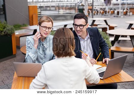 Chief Executive. Experienced Chief Executive Wearing Glasses Feeling Engaged In Joining His Female C