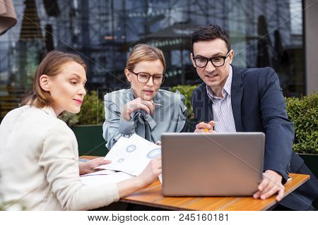 Career Woman. Stylish Successful Career Woman Wearing Glasses Holding Pencil In Her Hands Sitting Ne