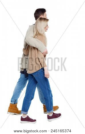 Side view of going couple. walking friendly girl and guy holding hands. Rear view people collection. backside view of person. Isolated over white background. Husband and wife on a walk.