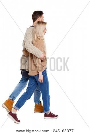 Side view of going couple. walking friendly girl and guy holding hands. Rear view people collection. backside view of person. Isolated over white background. Guy and girl are walking together