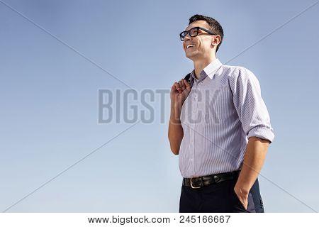 Career Man. Beaming Handsome Career Man Feeling Rather Secure After Attending Useful Team Building M