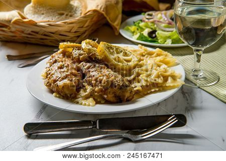 Italian American Chicken Francese With Farfalle Pasta And Side Salad