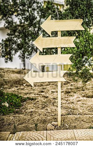 Direction Indicator. Wooden Signpost. Directions Four Signs To One Place Or Way