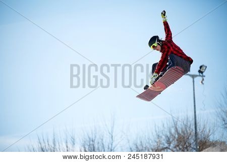 Photo of young athlete jumping with snowboard
