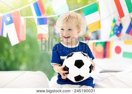 Child Watching Football Game On Tv. Little Boy In Brazil Tricot Watching Soccer Game During Champion