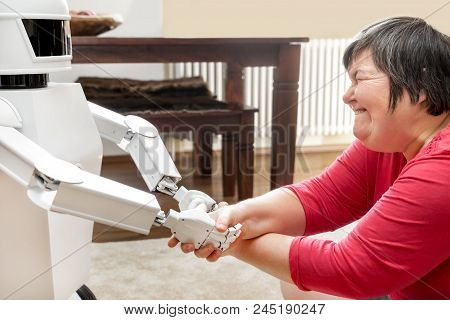 Medical Service Robot Is Giving A Mentally Disabled Woman The Hand, Learning With An Artificial  Int