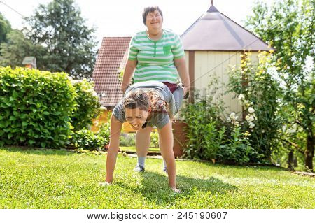 Mentally Disabled Woman Is Doing Exercises With An Therapist Or Trainer, Maybe A Good Friend.