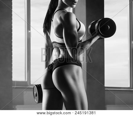 Cropped Black And White Photo Of Strong Fit Model Training In Gym , Doing Fitness Exercises With Hea