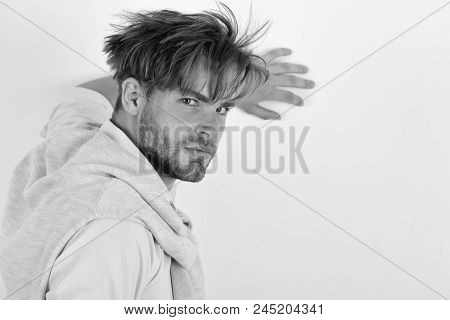 Guy With Bristle In Pink Shirt, Sweater Tied On Shoulders And Messy Hair. Man With Confident Face Is