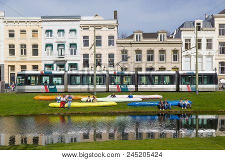 Coolsingel, Rotterdam, The Netherlands - April 7 2018: Tram On Busy Coolsingel, People Relaxing On A