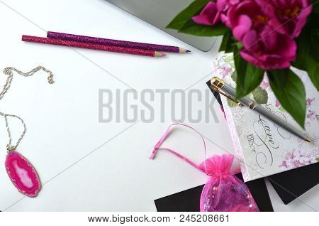 Bold Pink Peonies On White And Black Theme Workspace With Stationery Closeup.  Freelancing And Worki