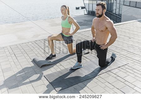 Fit Fitness Woman And Man Doing Fitness Exercises Outdoor At City Background. The Best Abdominal Mus