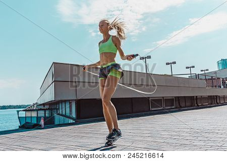 Fit Fitness Woman Doing Fitness Exercises Outdoors At City. Girl Doing Exercise With Jump Rope. Fema