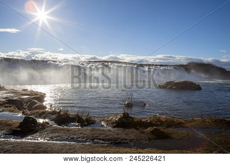 The Sun Shines Brightly At The Faxi Waterfall In Iceland