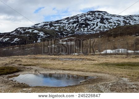 The Mountain Looms Over Geysir Park In Iceland