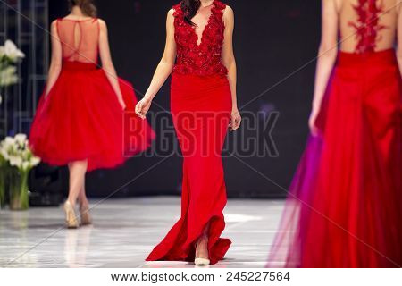Sofia, Bulgaria - 28 March 2018: Female Models Walk The Runway In Red Dresses During A Fashion Show.