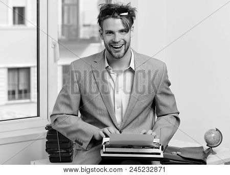 Man With Happy Face Types Story Or Business Report. Writer Or Businessman Wearing Grey Suit. Young A
