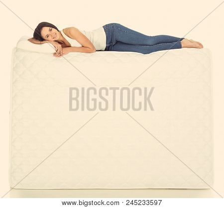 White Happy Beautiful Girl Isolated On White Lies On Mattress. Girl Resting Lying On Pillow. Rest Co