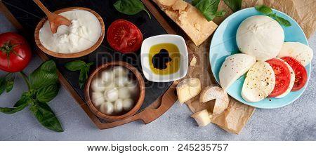 Italian Soft Cheeses Plate. Mozzarella Buffalo, Balls, Stracciatella, Basil Leaves, Tomatoes, Olive
