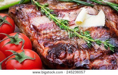 Medium Roasted Porterhouse Beef Steak Whith Vegetables On Wooden Background