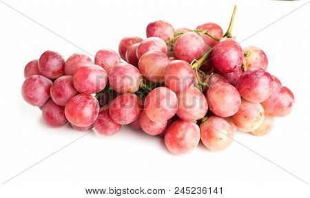 Isolated Bunch Of Rose Grapes On White Background
