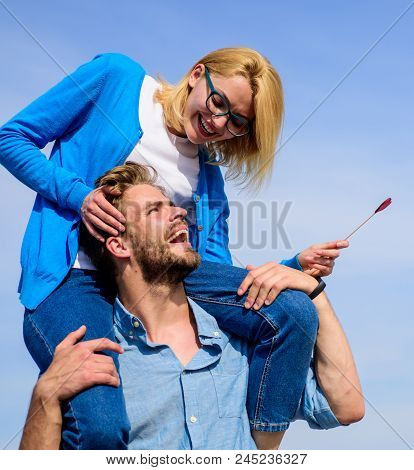Idyllic Date Concept. Man Carries Girlfriend On Shoulders, Sky Background. Woman Enjoy Perfect Roman