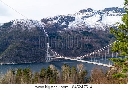 A Long Bridge Across The Hardangerfjord In Norway