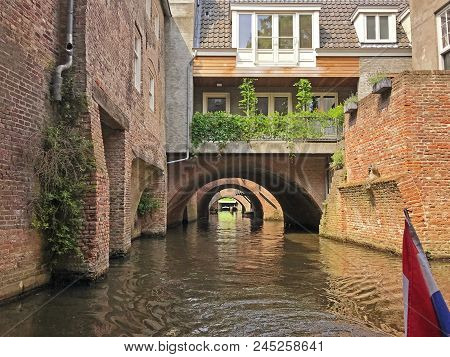 Beautiful Canal In Den Bosch Wtih Bridges And A House  With Space For Text.