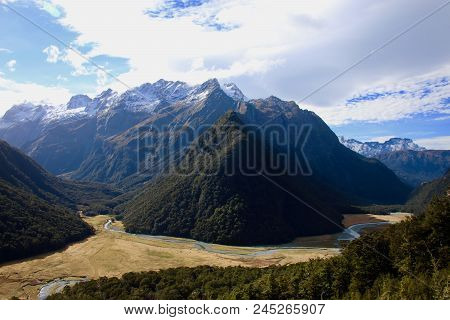Mountain Range With Valley Mountain Lakes And River During Sunset National Park, New Zealand Highlan