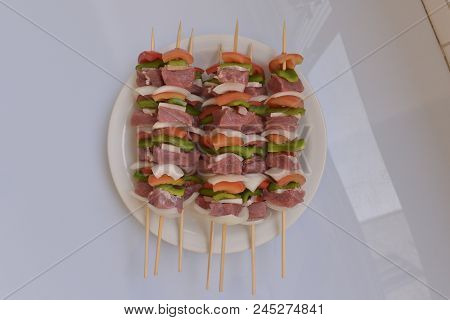 Mixed Barbecue Skewer Of Raw Meat And Vegetables