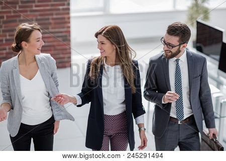 Manager meets customers in the office