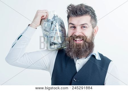 Successful Businessman Holds Jar With Money. Business Concept. Saving Money Concept. Business Succes